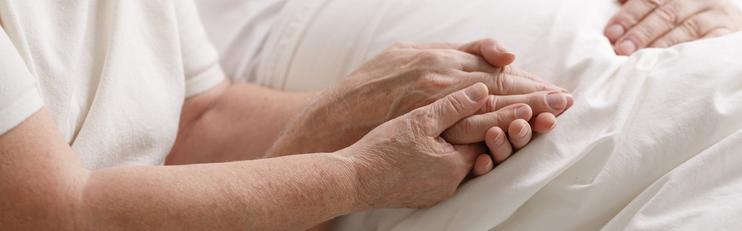 envato-elements/envato-elements-people-holding-hands-in-hospital-PDR2TGZ-gz5.jpg