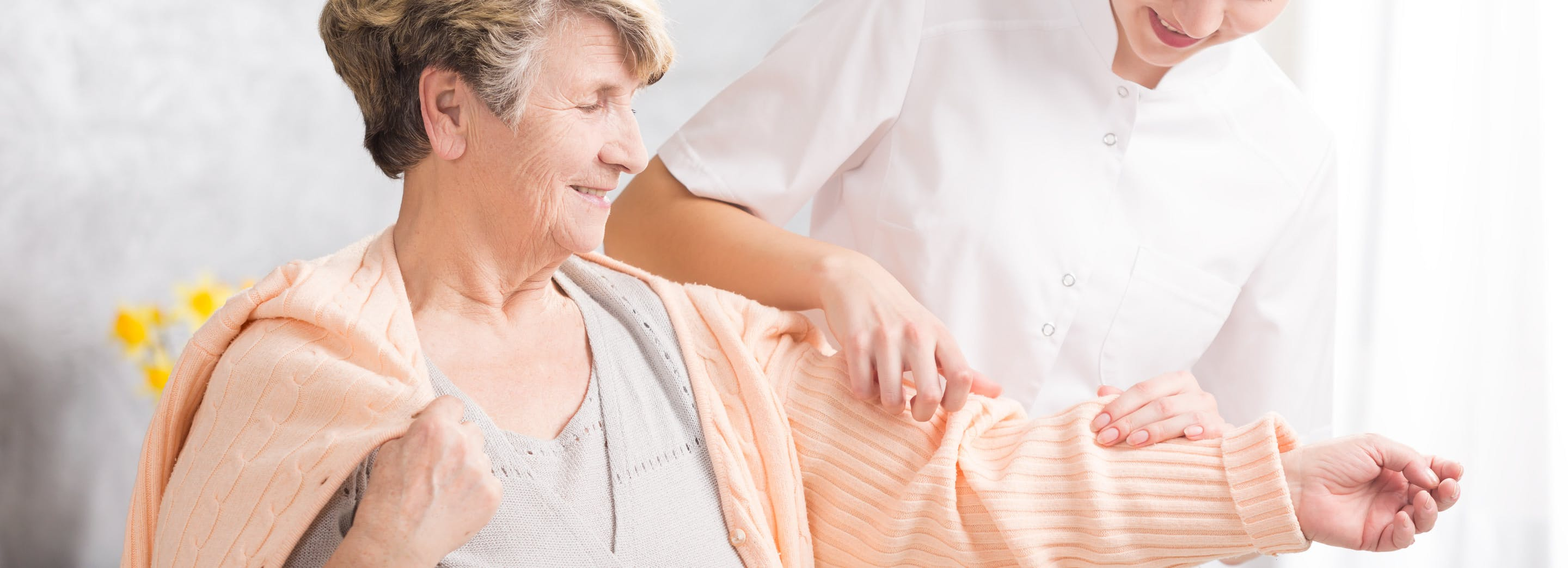 envato-elements/envato-elements-young-nurse-helping-elderly-woman-PAWNESZ-gz5.jpg